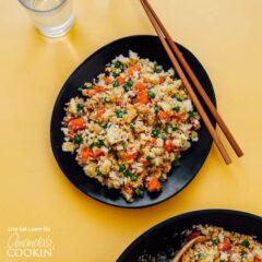 black bowl with cauliflower fried rice and chop sticks