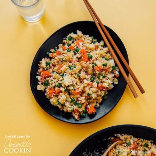 black bowl with cauliflower fried rice and chop sticks