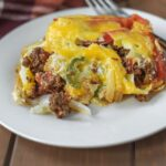 plate with casserole topped with cheese