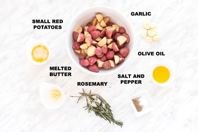 ingredients for roasted potatoes: red potatoes, garlic, butter, olive oil, rosemary, salt, and pepper