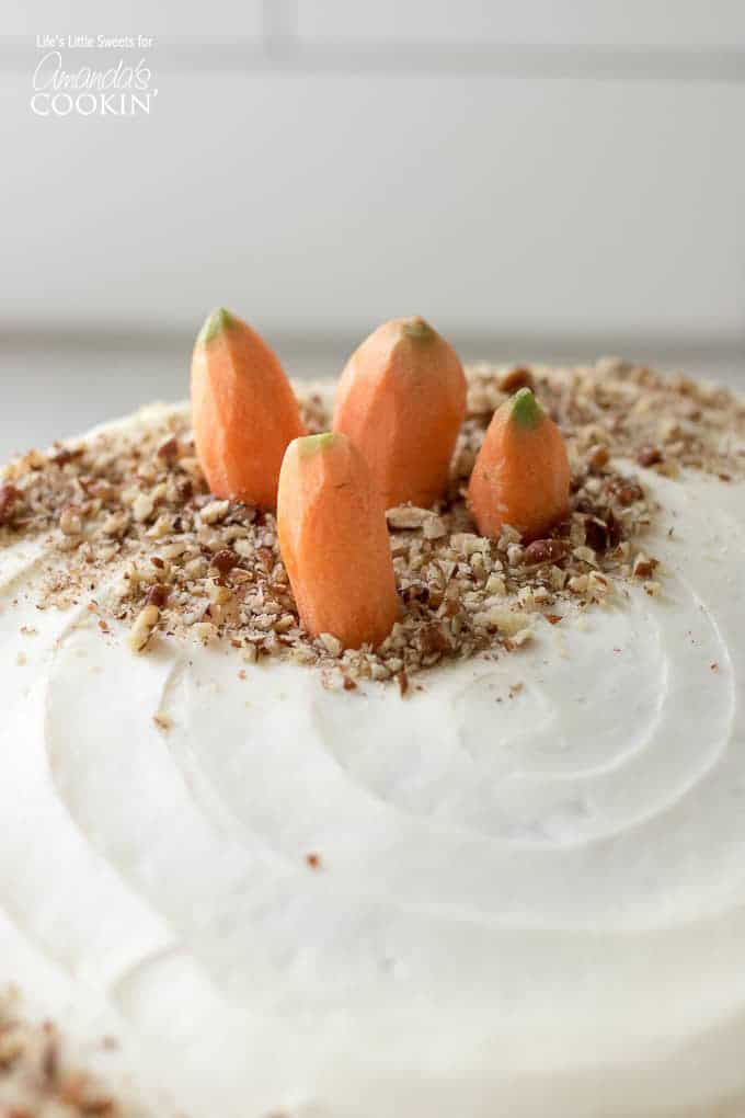 small carrots on top of carrot cake