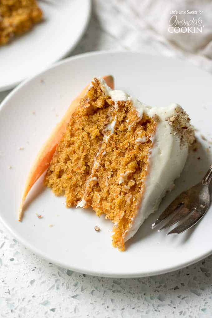 slice of carrot cake with carrot on the side