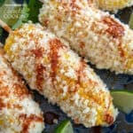 Mexican Corn on the cob with cheese, mayo and Latin spices makes the best summer food! Enjoy this Mexican street food anytime with this easy recipe!