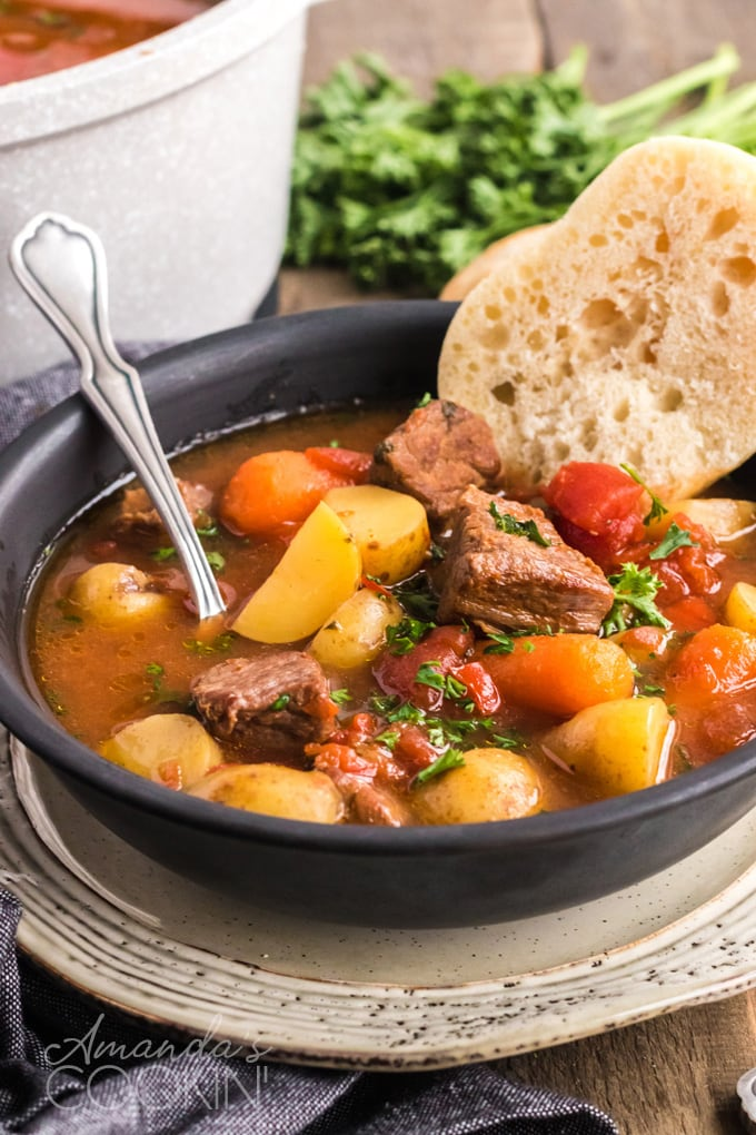 bowl of goulash with bread