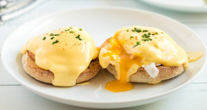 two eggs benedict on a plate