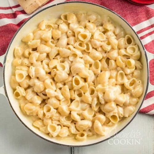 A bowl of pasta and cheese