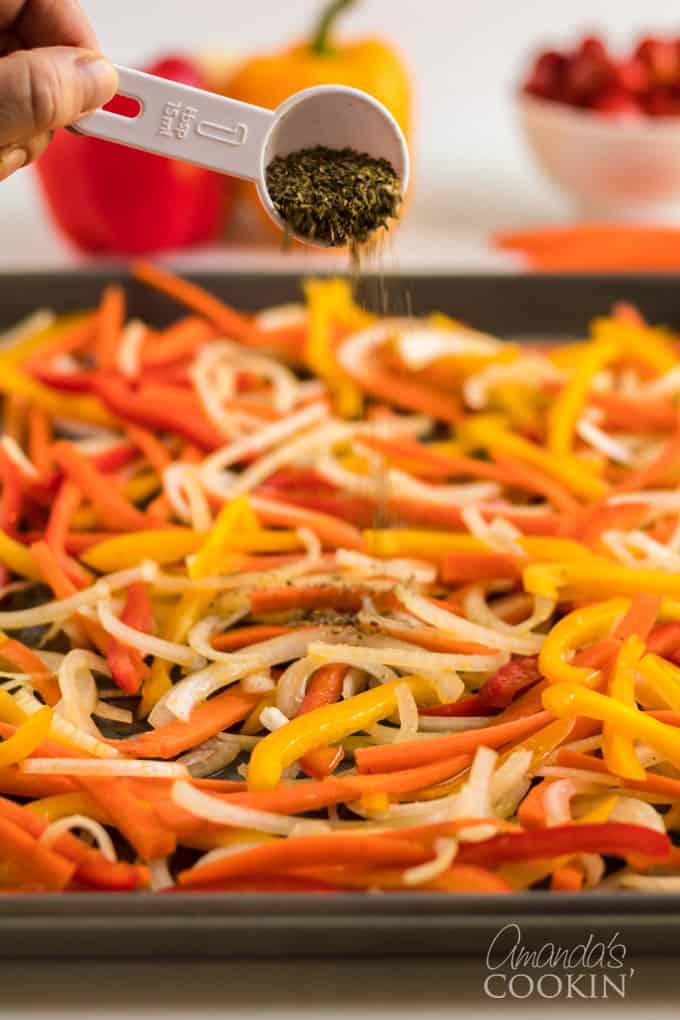 sprinkling dried herbs onto fresh vegetables