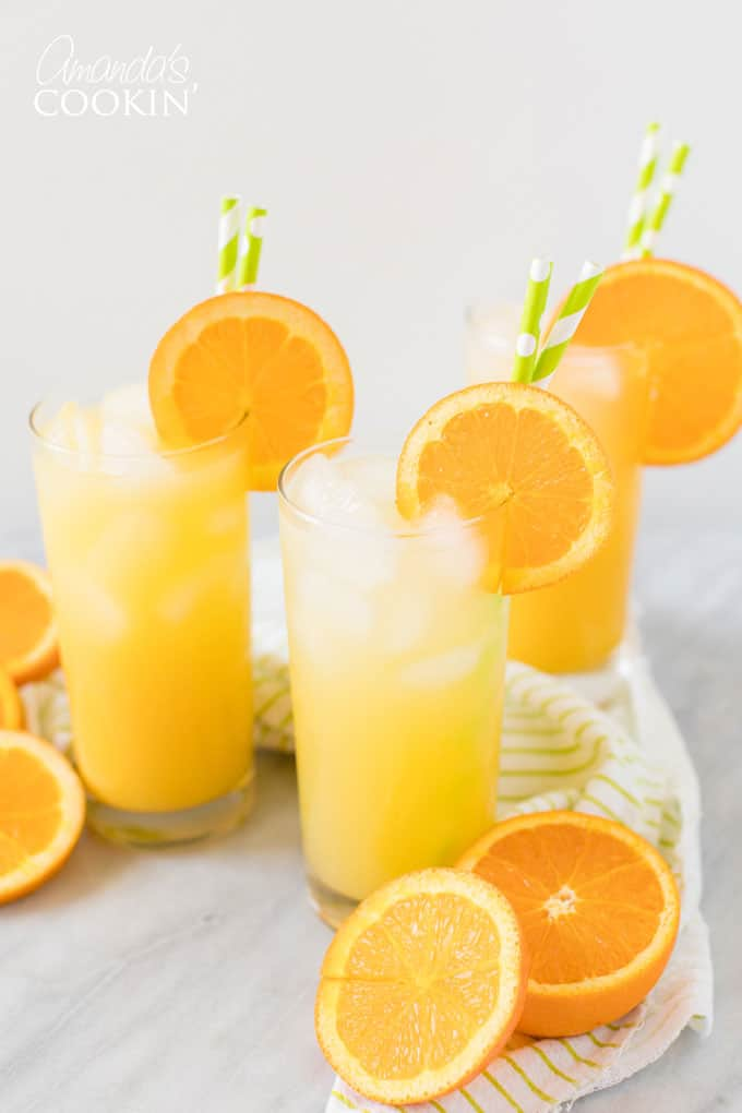 screwdriver drink in highball glass with slice or orange garnish
