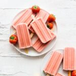 strawberry popsicles on a plate