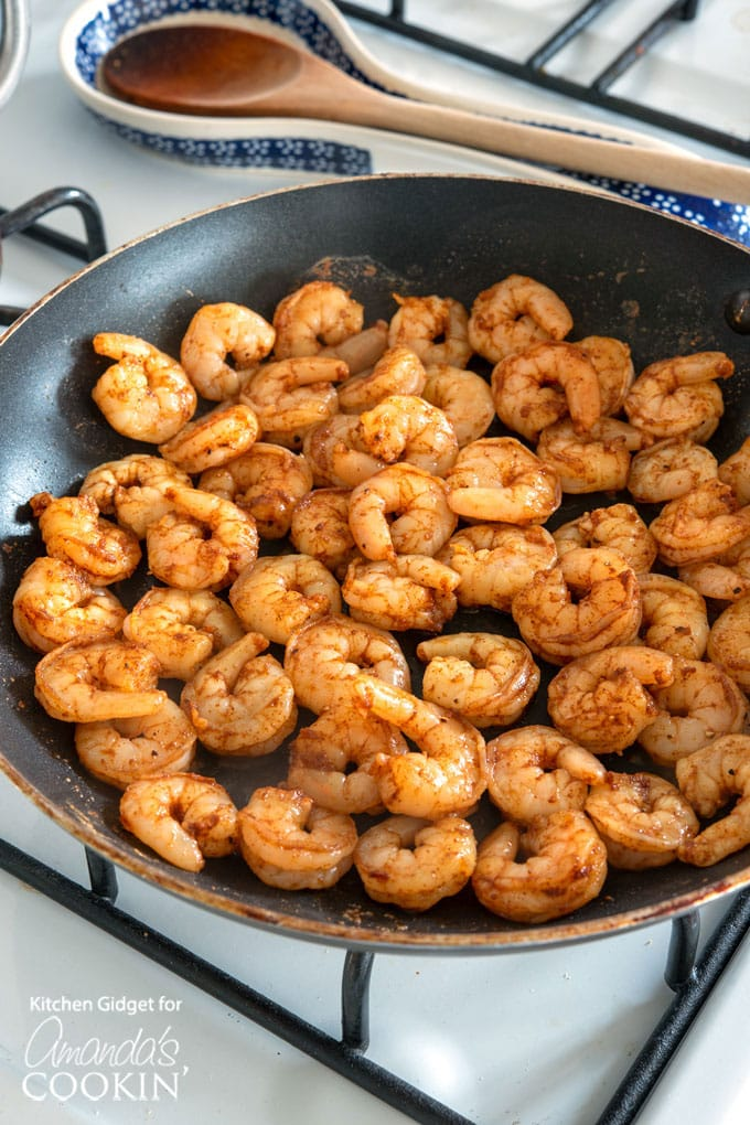 cooking seasoned shrimp in skillet