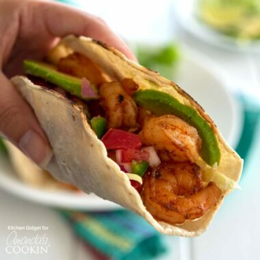This recipe for Shrimp Tacos is easy to make and so delicious! Plump and juicy shrimp nestled inside tortillas make for an easy weeknight dinner.
