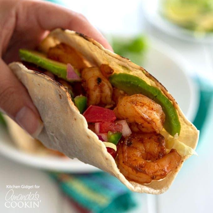 hand holding shrimp taco