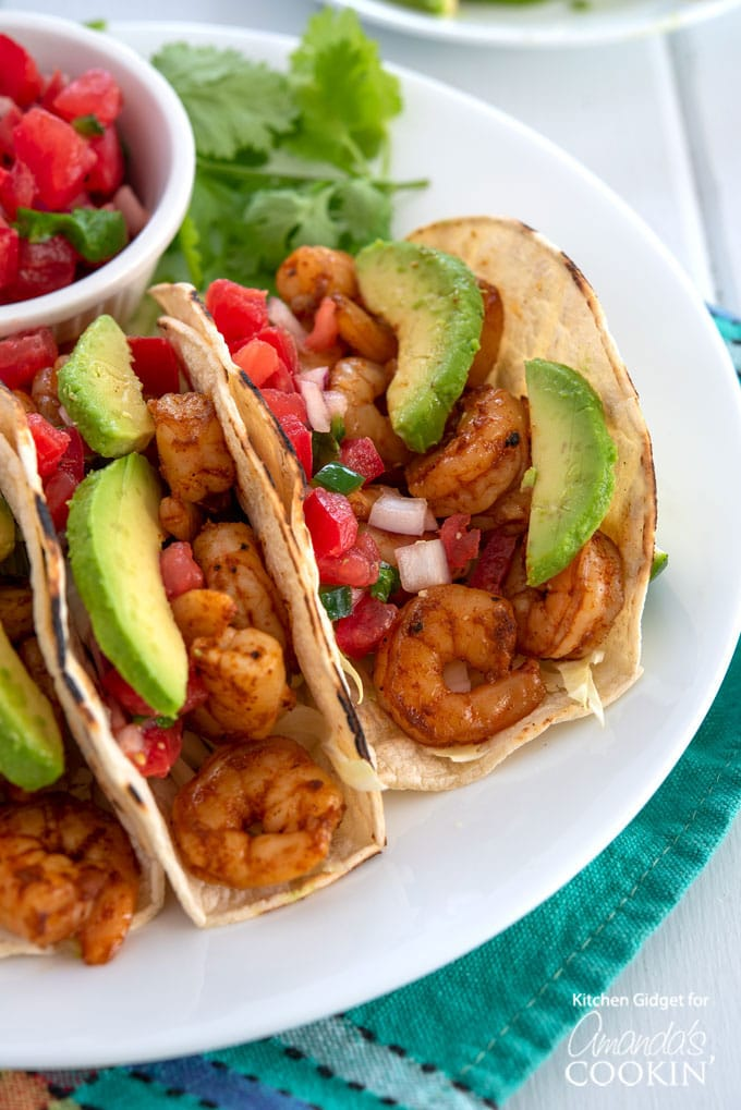 shrimp tacos with avocado and pico de gallo