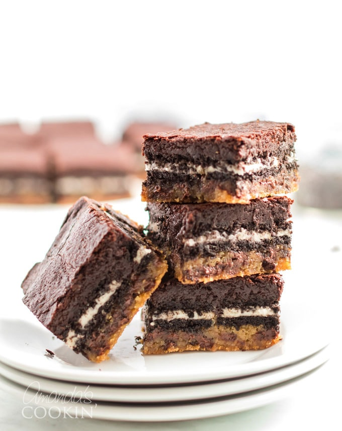 stack of brownies made with oreos and chocolate chip cookie dough