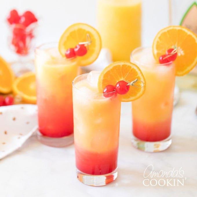 3 glasses of tequila sunrise