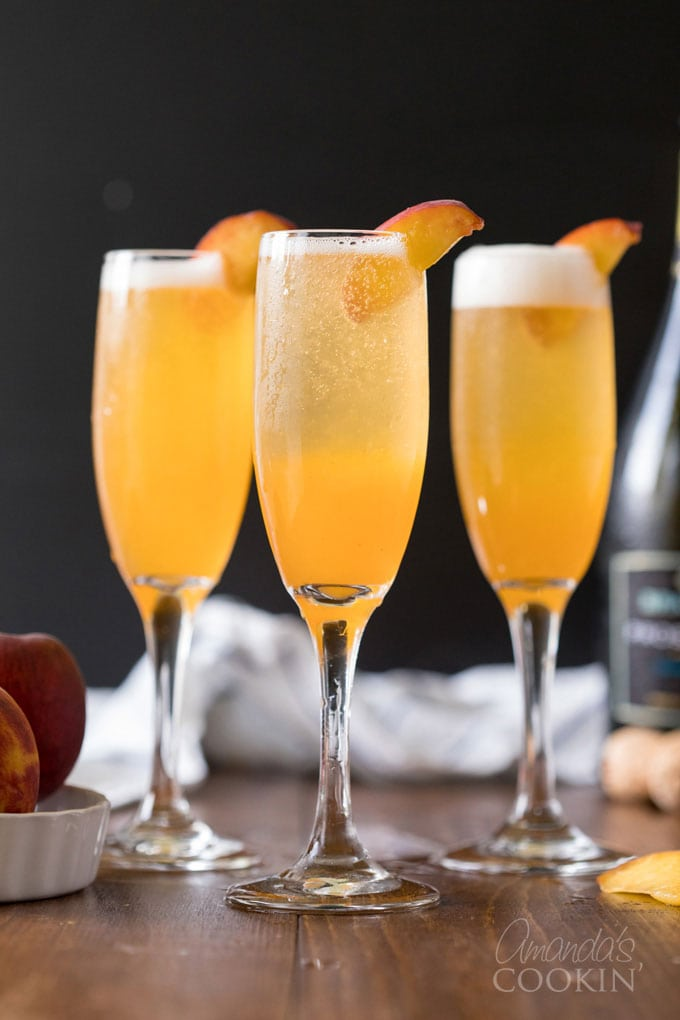 bellini cocktails in champagne flutes