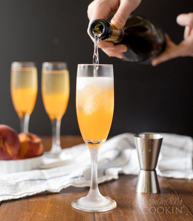 pouring Prosecco into champagne flute