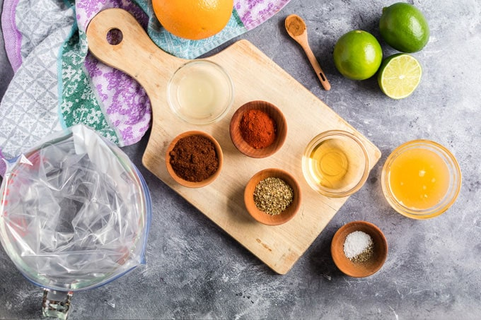 ingredients for chicken tacos laid out on cutting board