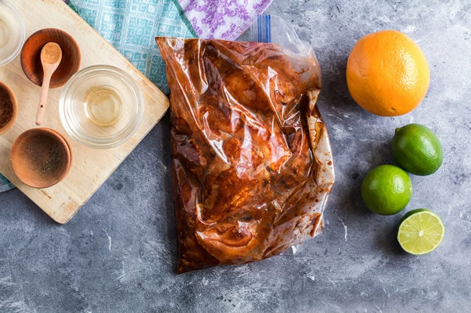 chicken marinating in a plastic bag