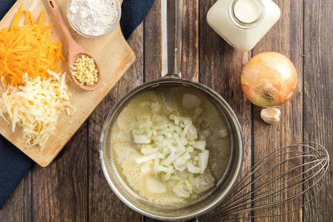 saucepan with melted butter and onion