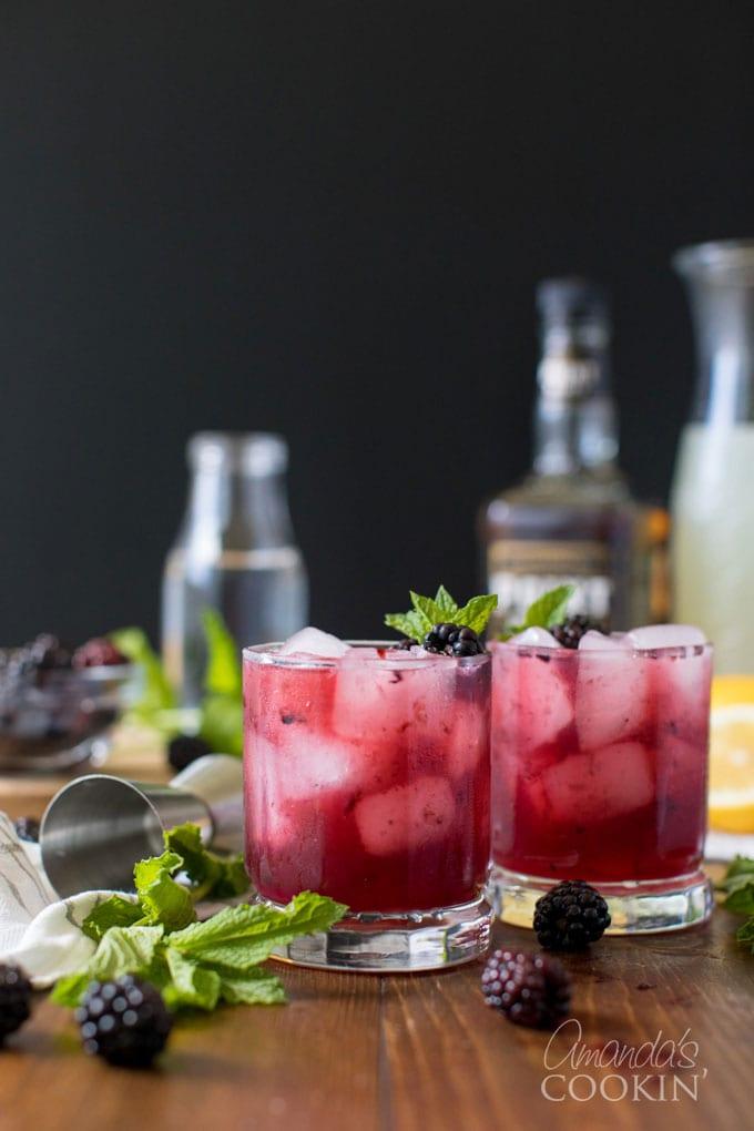 two glasses of blackberry bourbon lemonade cocktail