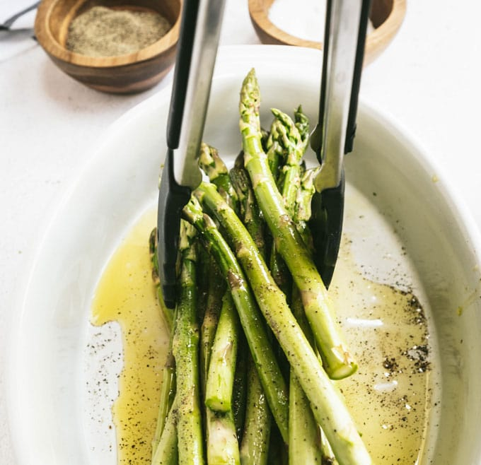 lifting asparagus with tongs