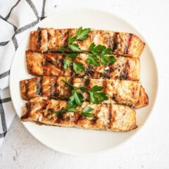 grill salmon garnished with parsley