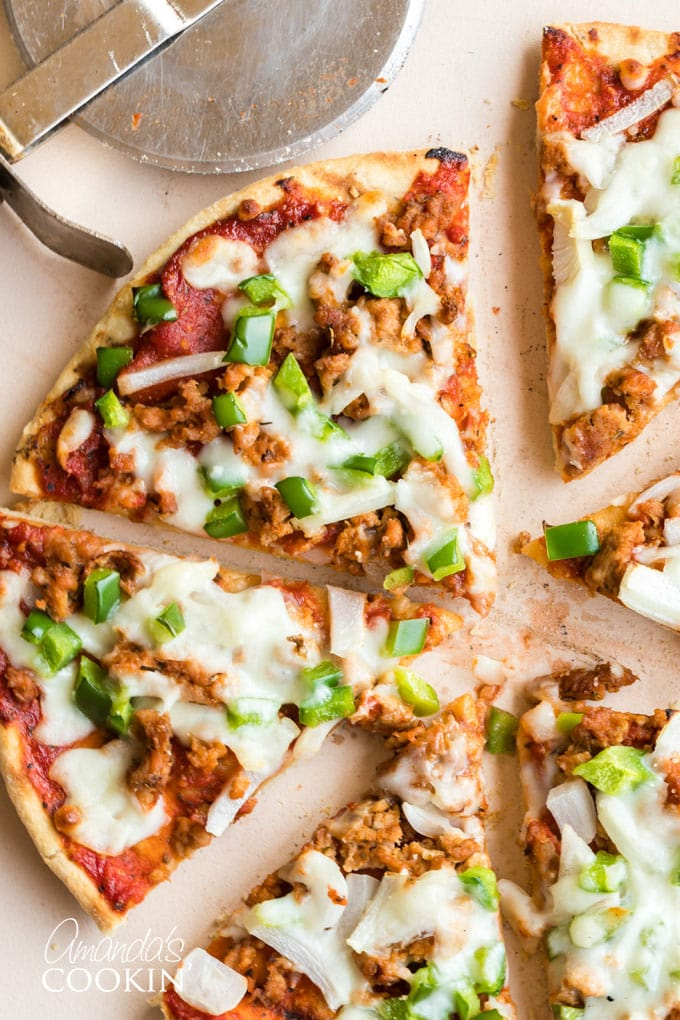 slices of homemade pizza with sausage and green pepper