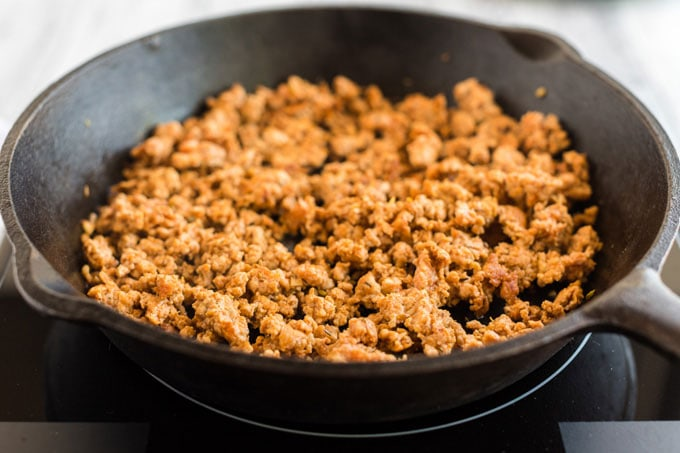 browned ground pizza sausage in a skillet