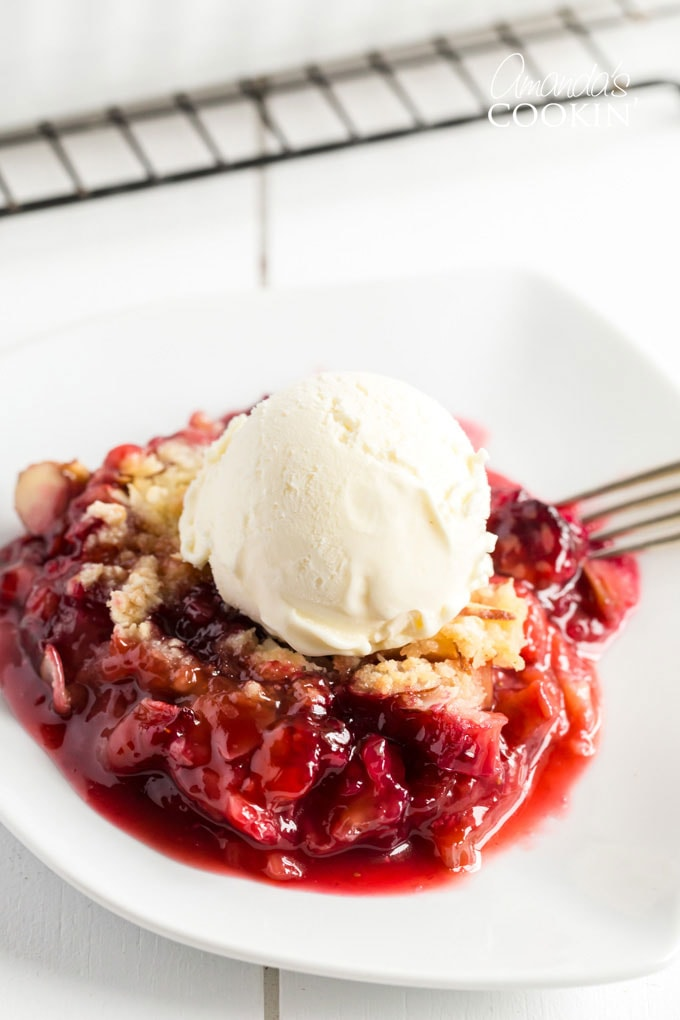 rhubarb crumble with ice cream on a plate