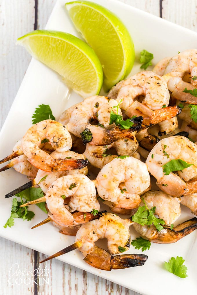 plate of skewered grilled shrimp