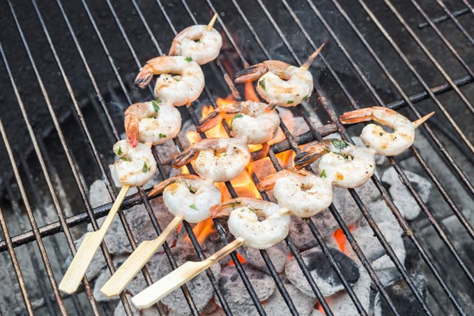 skewered shrimp on a charcoal grill