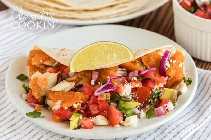 fish taco with toppings on plate