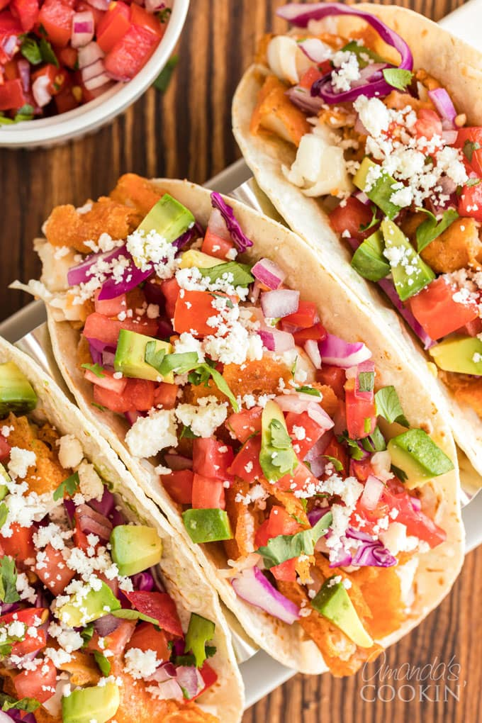 overhead view of fish tacos with toppings
