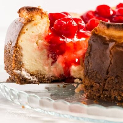 slice of cherry cheesecake being removed with pie server