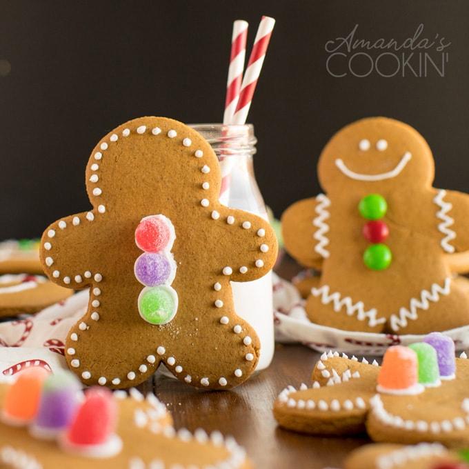 gingerbread man cookie near bottle of milk