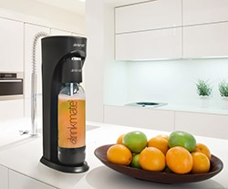 A bowl of oranges on a kitchen counter, with DrinkMate and Carbonation