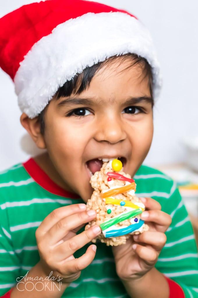 little boy eating a Christmas Tree Rice Krispie Treat
