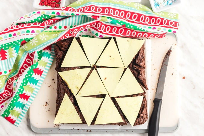 brownie pan with paper triangles on top
