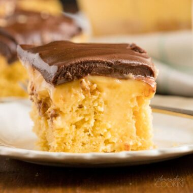 slice of boston cream poke cake on a white plate