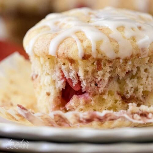 close up of strawberry muffin on a plate