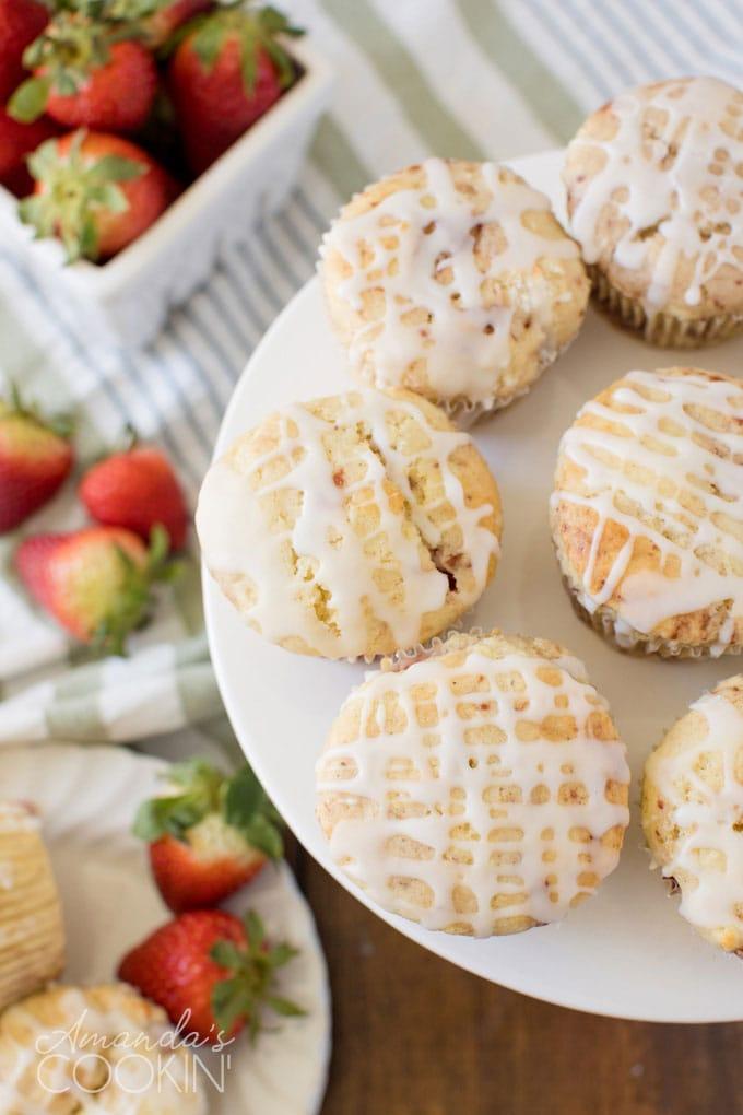plate full of glazed strawberry muffins