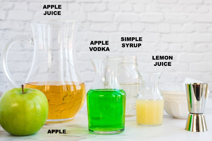 ingredients for an appletini - apple juice, apple vodka, lemon juice and simple syrup