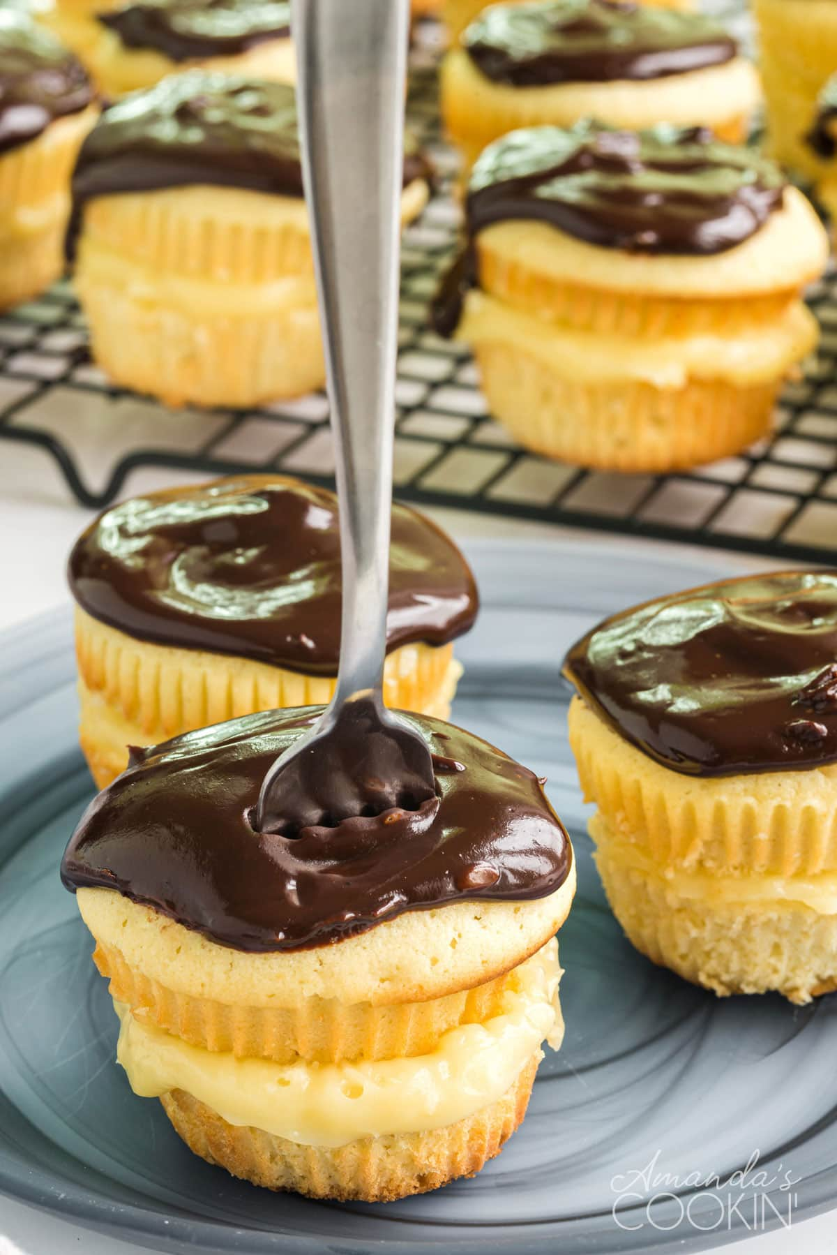 boston cream cupcake with a fork standing in the top of it