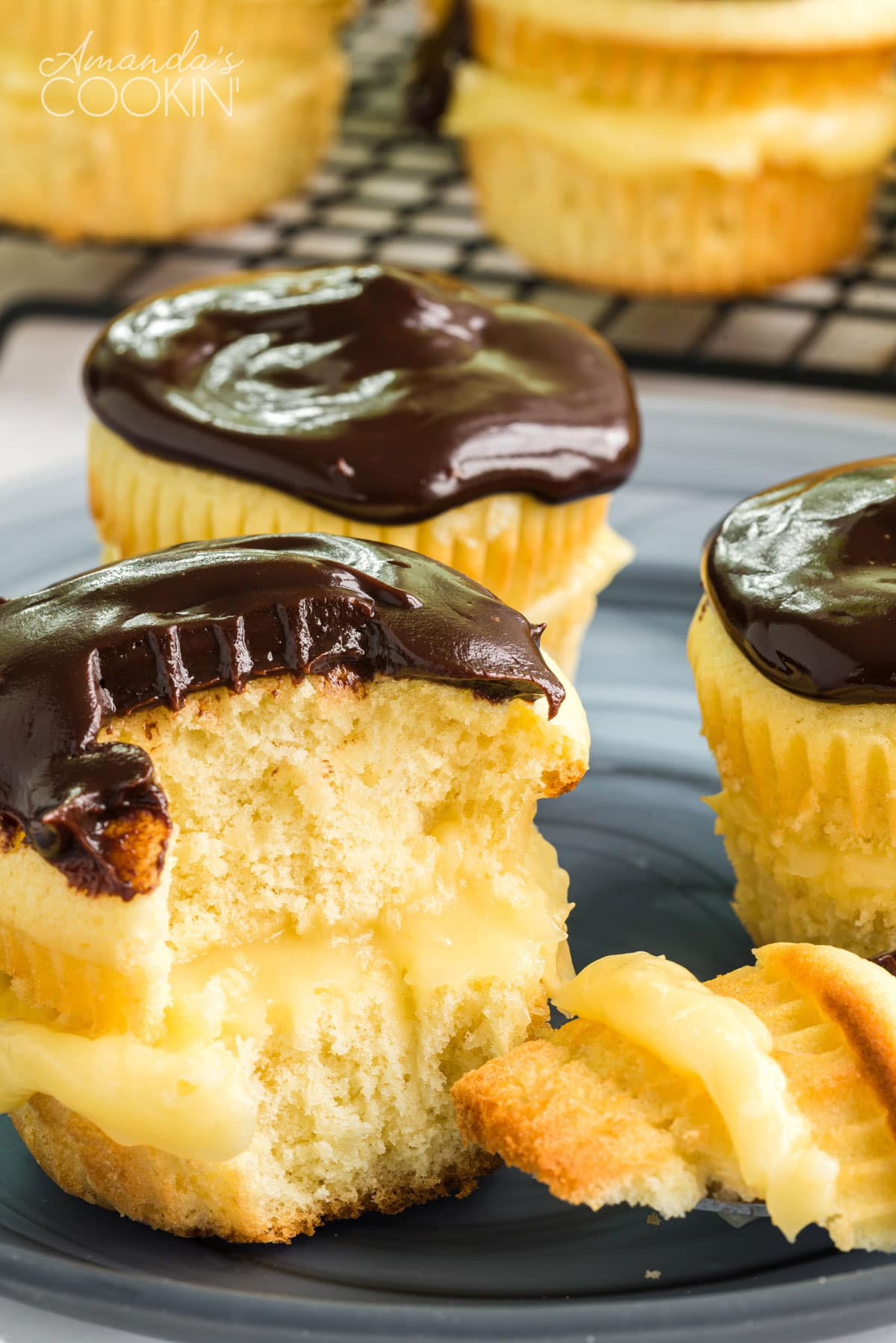boston cream pie cupcake with a chunk out of it