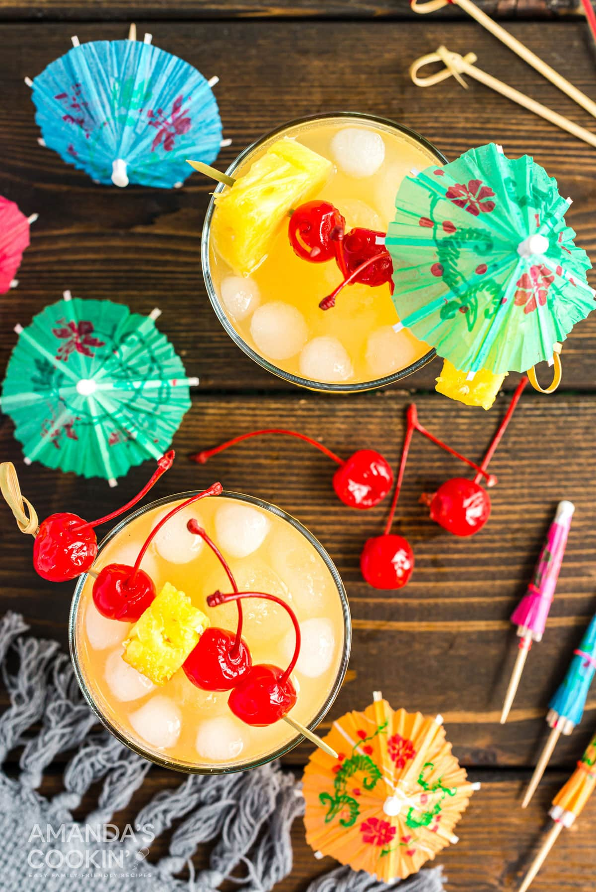 overhead photo of mai tai cocktails with cherry garnishes