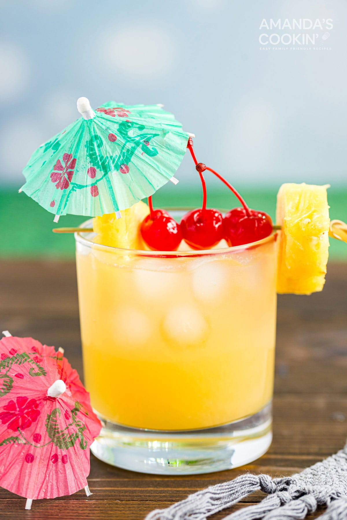 Mai Tai cocktail in a rock glass served with a cocktail umbrella