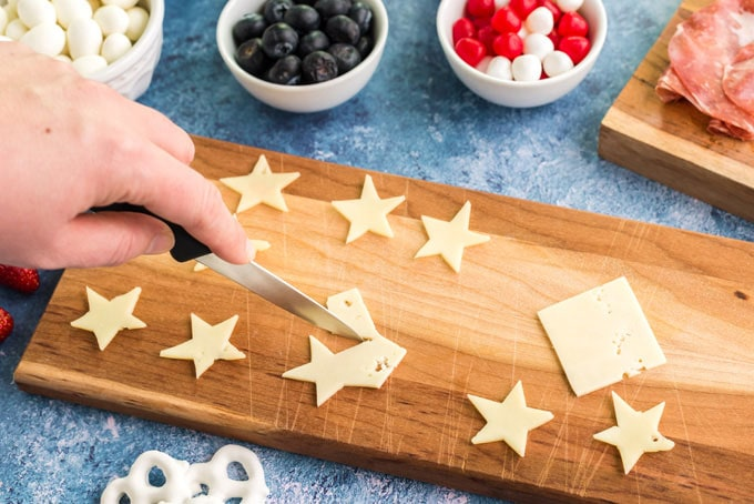 cutting cheese slices into star shapes