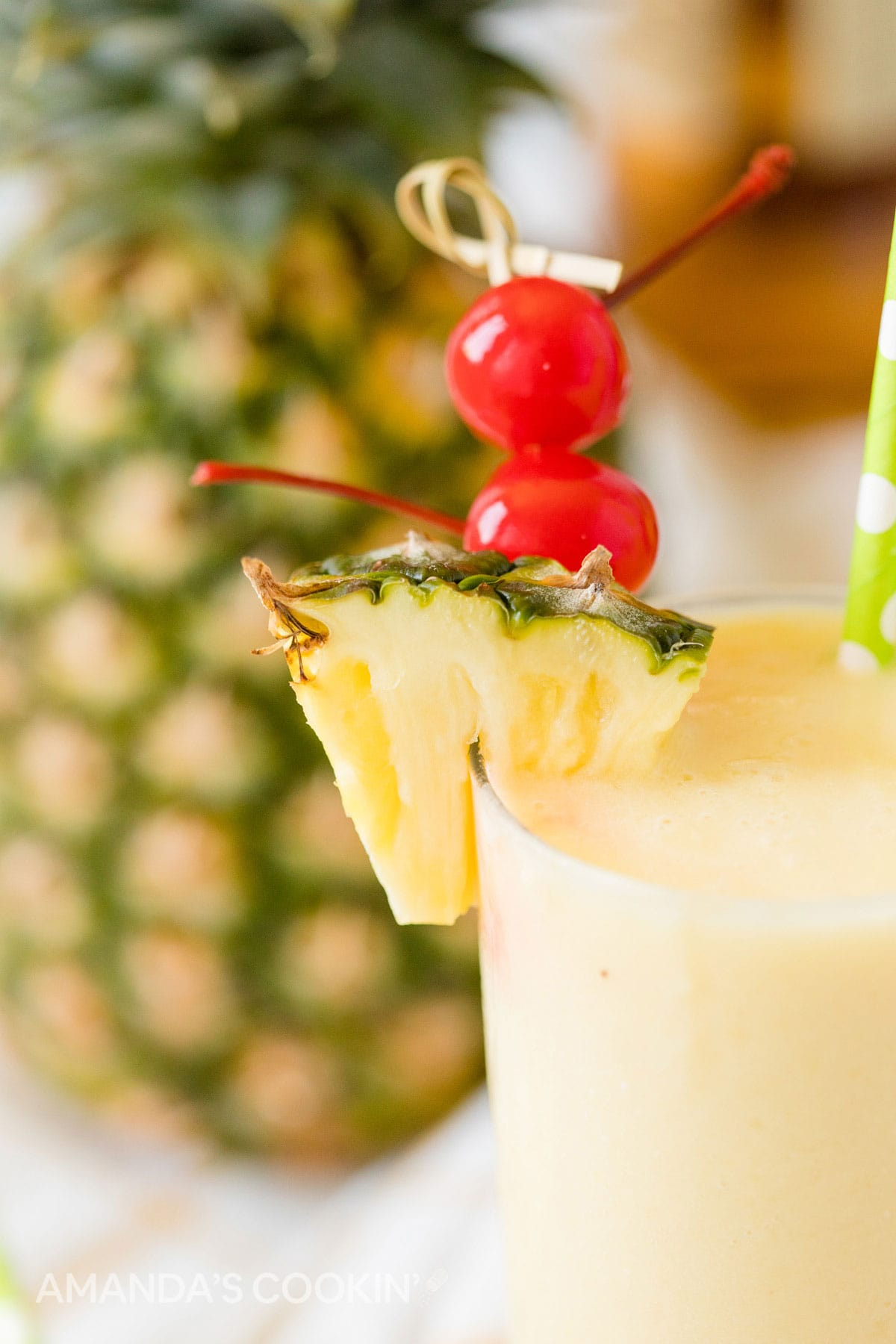 close up of cherry and pineapple garnishes on pineapple rum slush cocktail