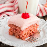 slice of cherry cake on plate with a fork